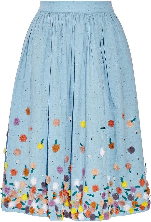 Помпоны – тренд сезона красивая юбка с многочисленными разноцветными помпонами.