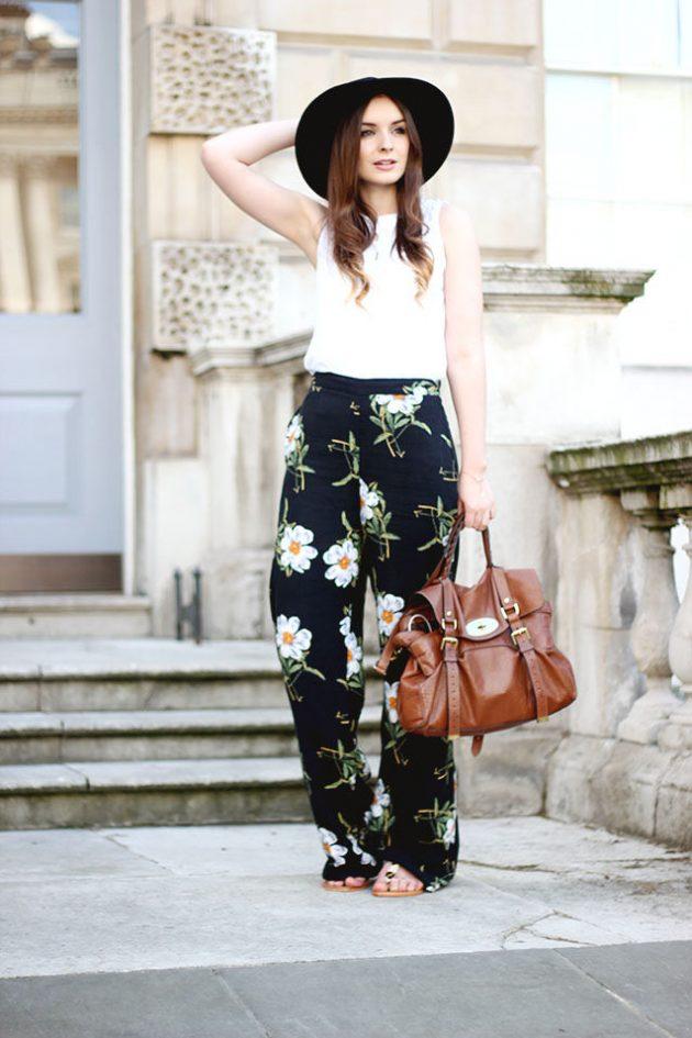На фото: черные брюки Палаццо с белым цветочным принтом и белым топом.