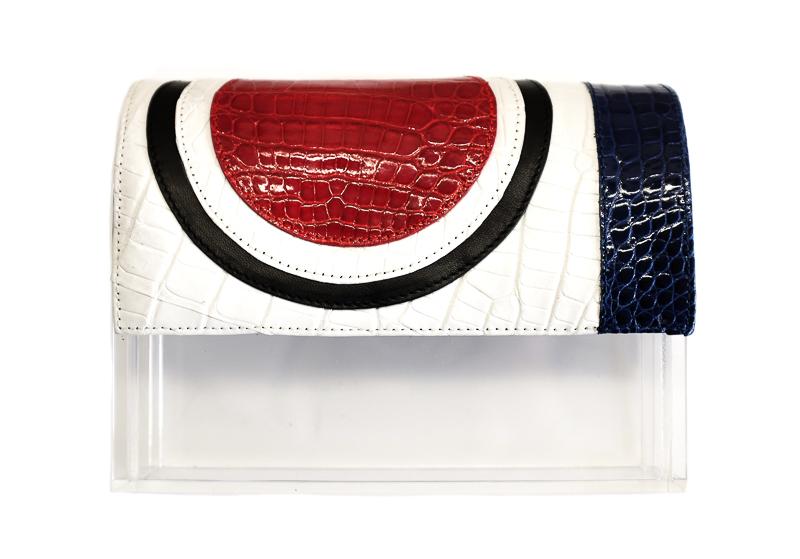 На фото: сумочка кланч с рисунком в виде прямых линий и окружности - новинка сезона из коллекции Hugo-Matha.