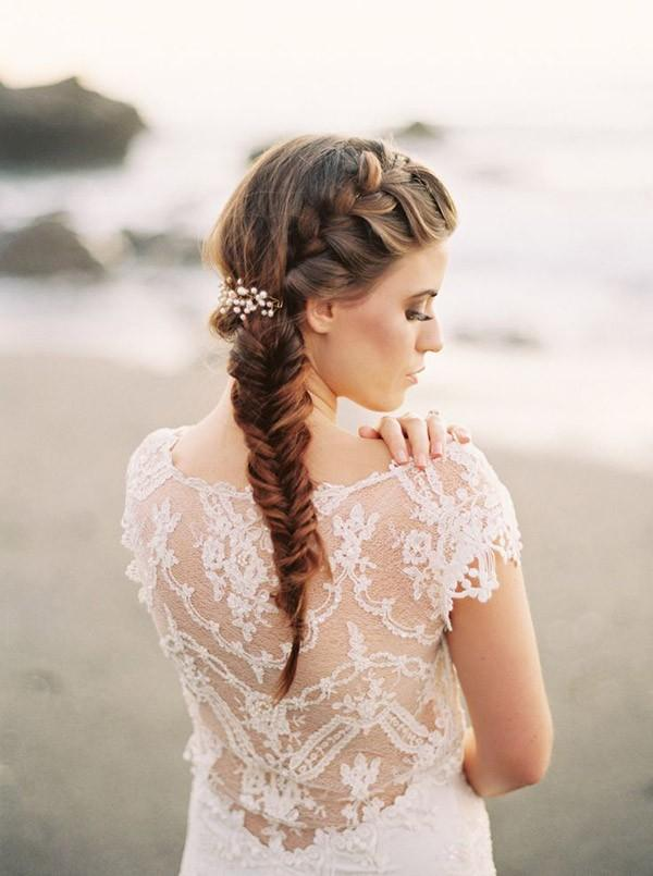 На фото: свадебная прическа - объемные косы на длинных волосах.
