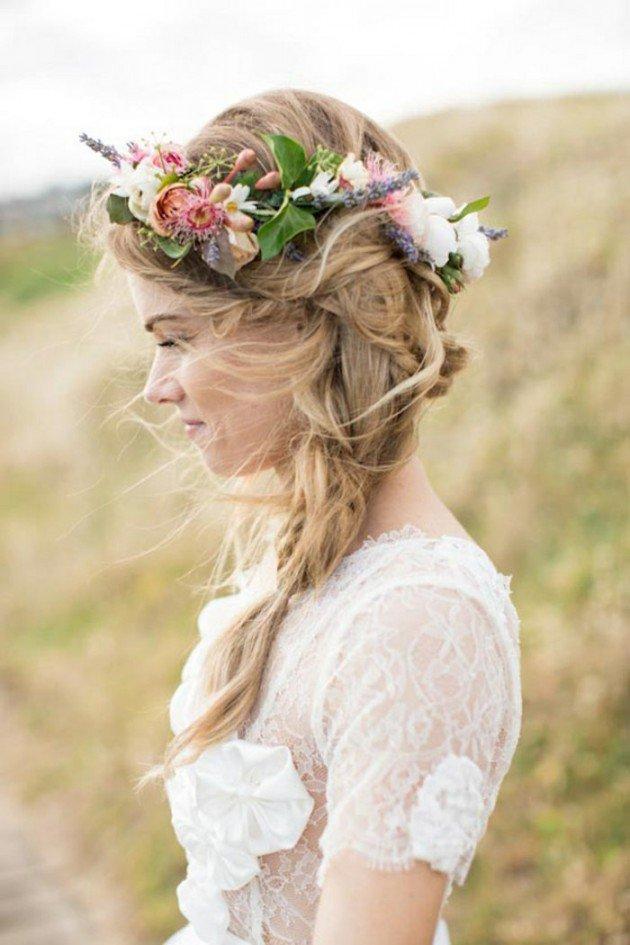 На фото: свадебная прическа - объемная косы на длинных волосах и цветы в виде венка.