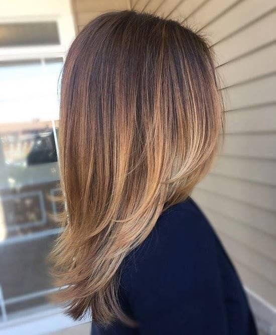 Красивая роскошная стрижка для длинных волос женщин 40 лет
