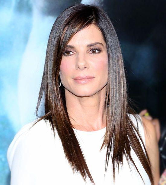 Стильная и элегантная стрижка для длинных волос женщины среднего возраста